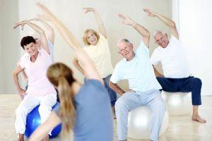 Seniors stretching while sitting