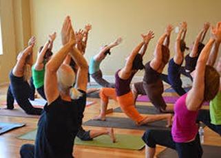 Adults doing yoga